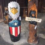 $350.00 eagle head bear in log with welcome $300.00